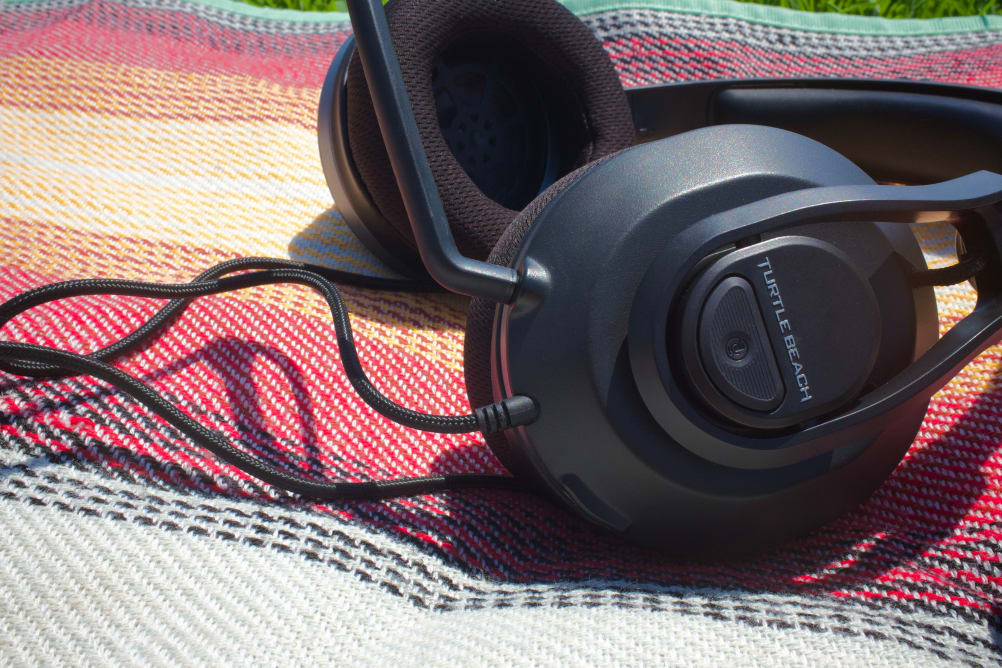 A gaming headset on top of a colorful blanket.