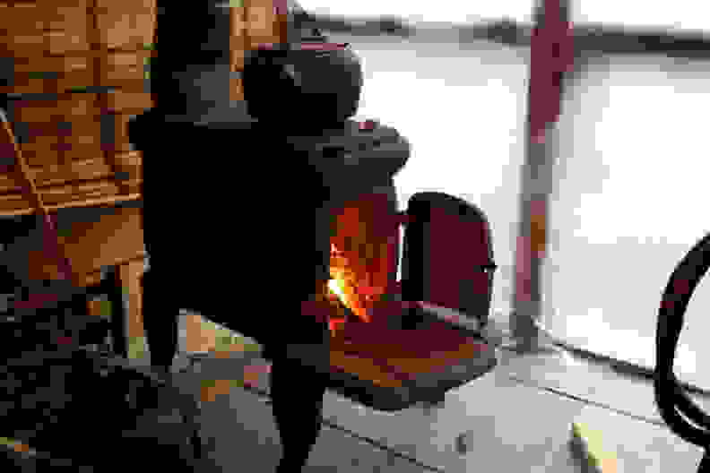 A classic wood-burning stove with stovetop