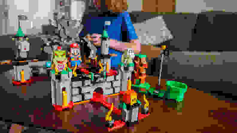 A child plays with the Bowser's Castle Boss Battle expansion set.