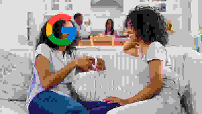 Two women talking but one of their heads is the Google logo