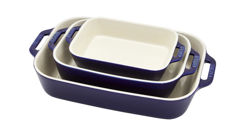 An image of three blue and white Staub baking dishes stacked together.