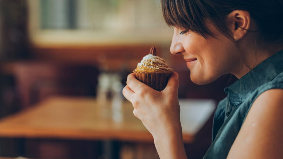 Person sniffing cupcake.