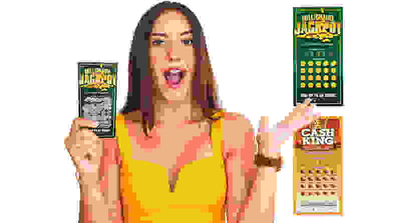 Girl with shocked expression holding fake scratch off tickets.