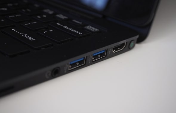 Ports on the right-side include two USB 3.0 slots, an HDMI output, and a headphone jack.