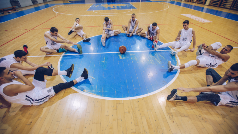 Basketball team stretching