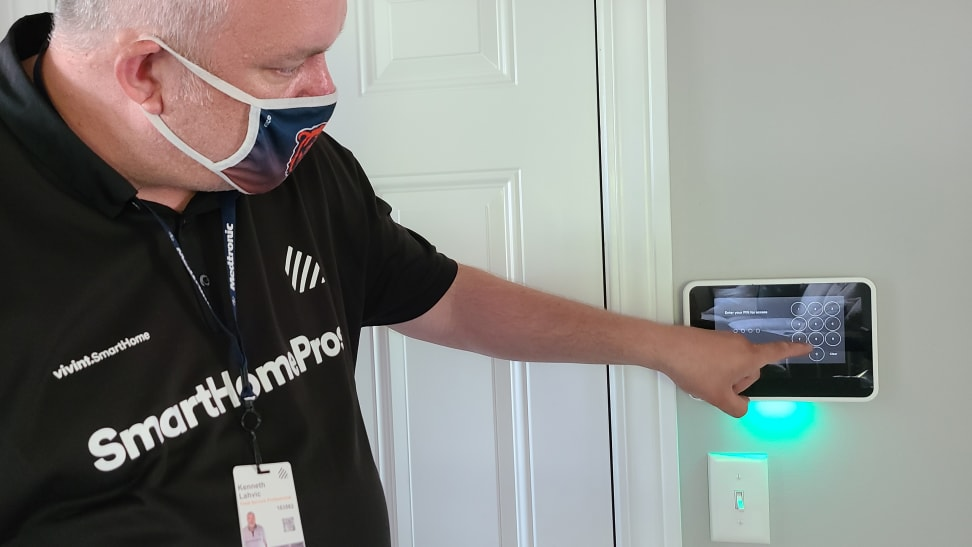 Person touching screen of Vivint hub