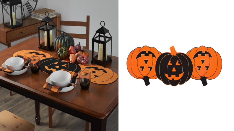 An image of a pumpkin table runner featuring three pumpkins linked together, two orange and one black at the center.