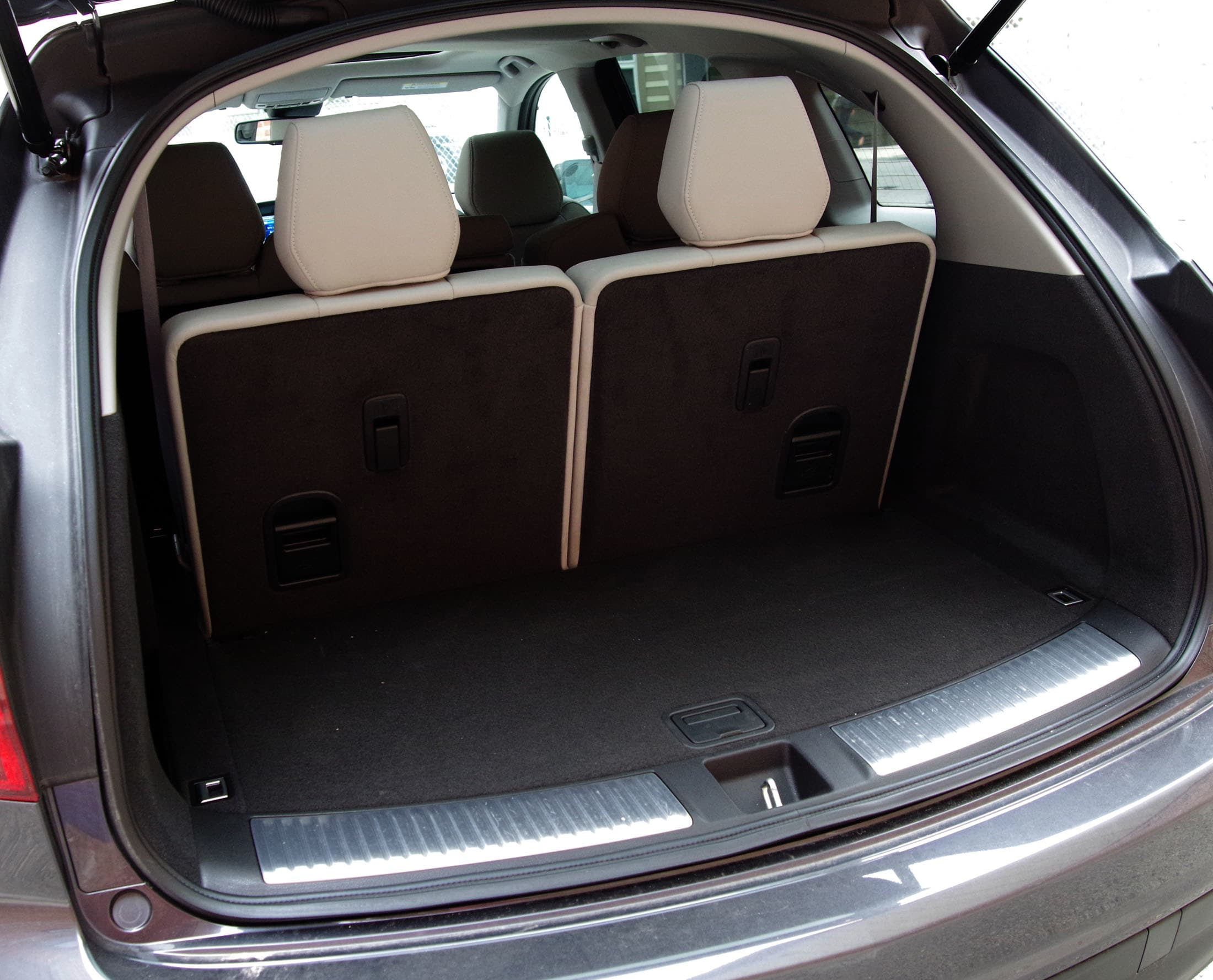 The 2014 Acura MDX's rear cargo area with all seats up,