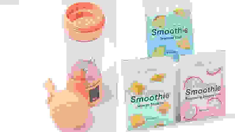 blush pink blender next to smoothie packets