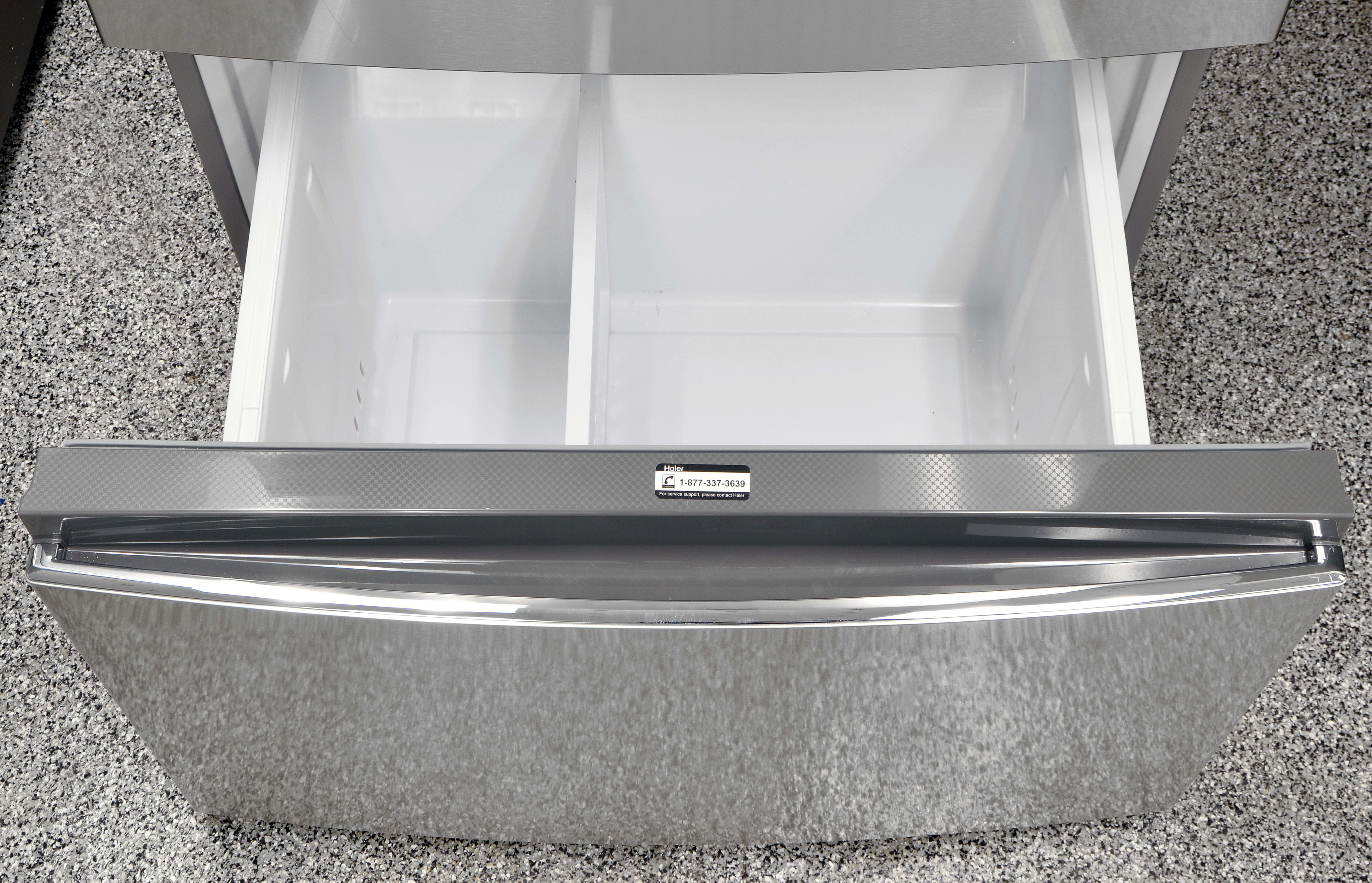 The Haier HRF15N3AGS's lower freezer drawer has an adjustable partition, and is taller than the upper one.