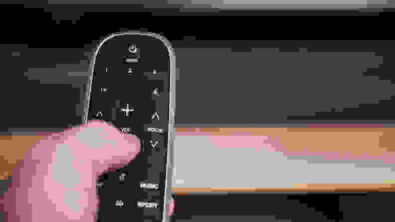 Polk Magnifi 2 remote in hand