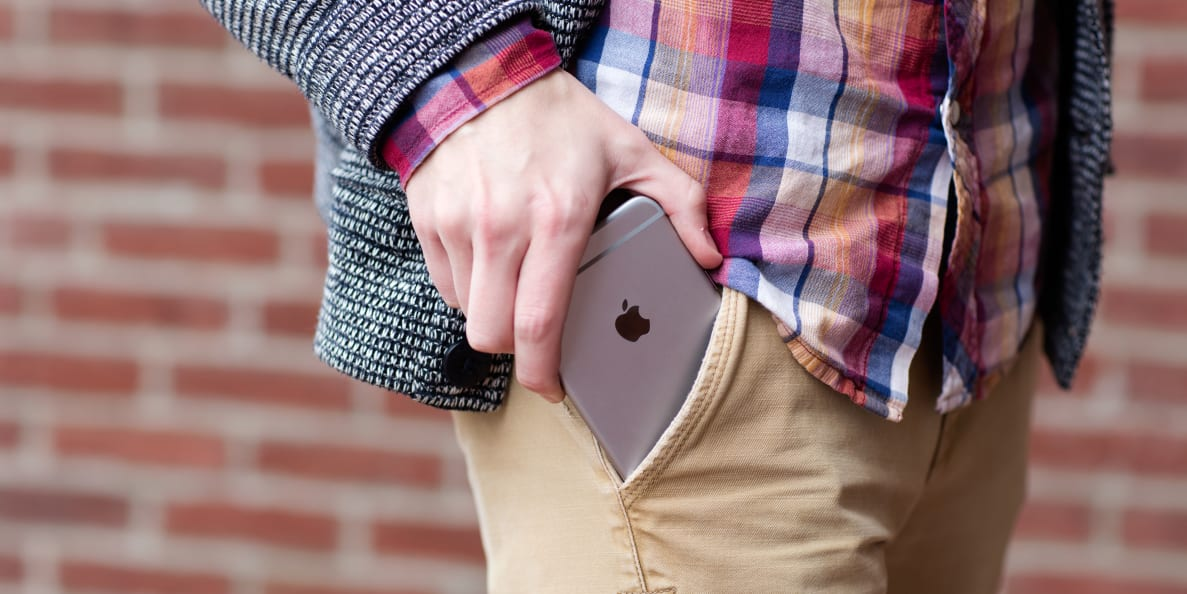 An iPhone 6s Plus trying desperately to fit into a pocket