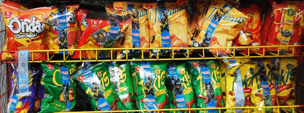 A shelf full of processed junk food.