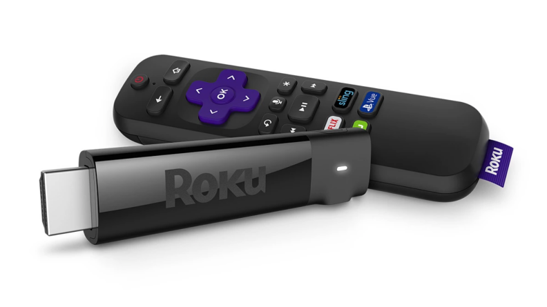 Someone holding a small Roku station