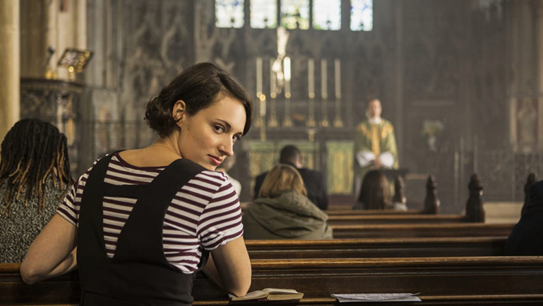 A still from the series Fleabag featuring Phoebe Waller-Bridge in a church.