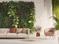 Modern-styled living room with cream couch paired with neutral-toned pillows, chair, and plants.