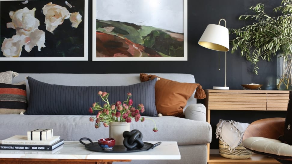 Two large artwork prints hanging above a couch in living room