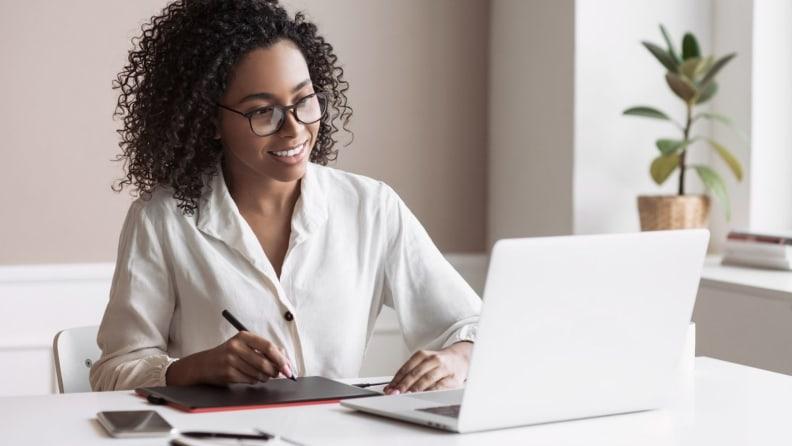 A woman using  a laptop.
