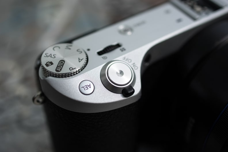 The shutter and power lever are located forward of the top controls.