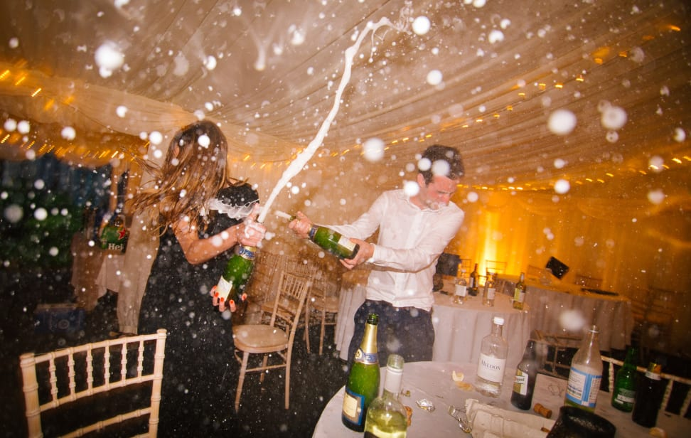 Partygoers celebrate with sparkling wine