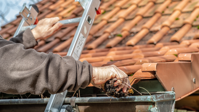 If your gutters are filled with leaves, snow, or other debris, the water may back up and freeze, creating an ice dam