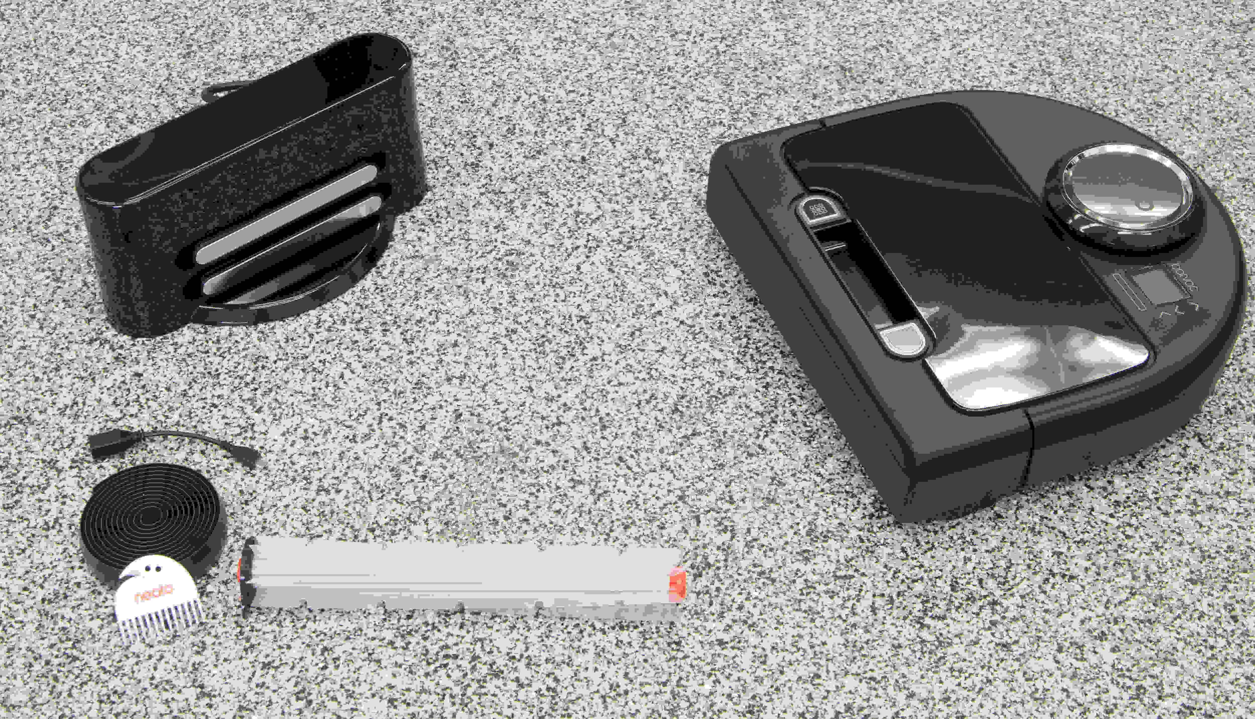 The Neato comes with a brush cleaner, a magnetic strip, a charger, and a USB cable.