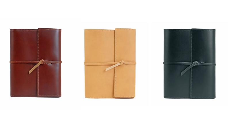 Three leather-bound journals.