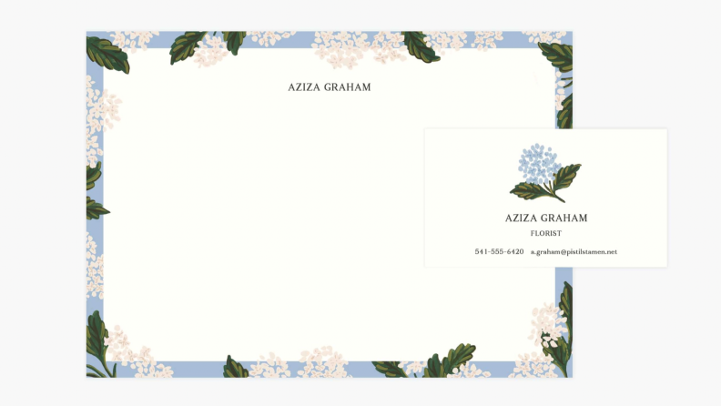 Personalized stationery and business card with floral designs.