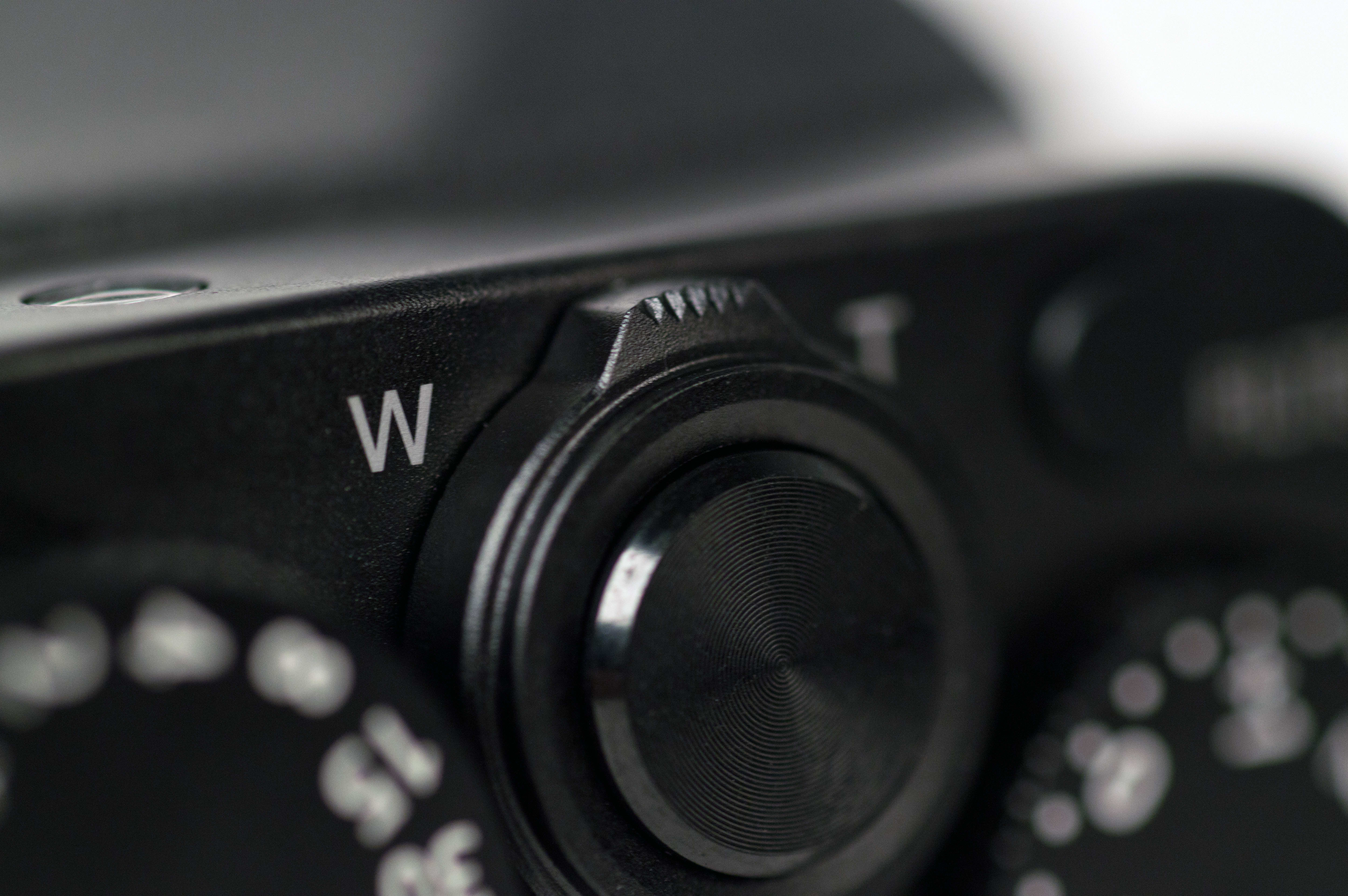 A photograph of the Panasonic Lumix LX100's zoom slider and shutter release.