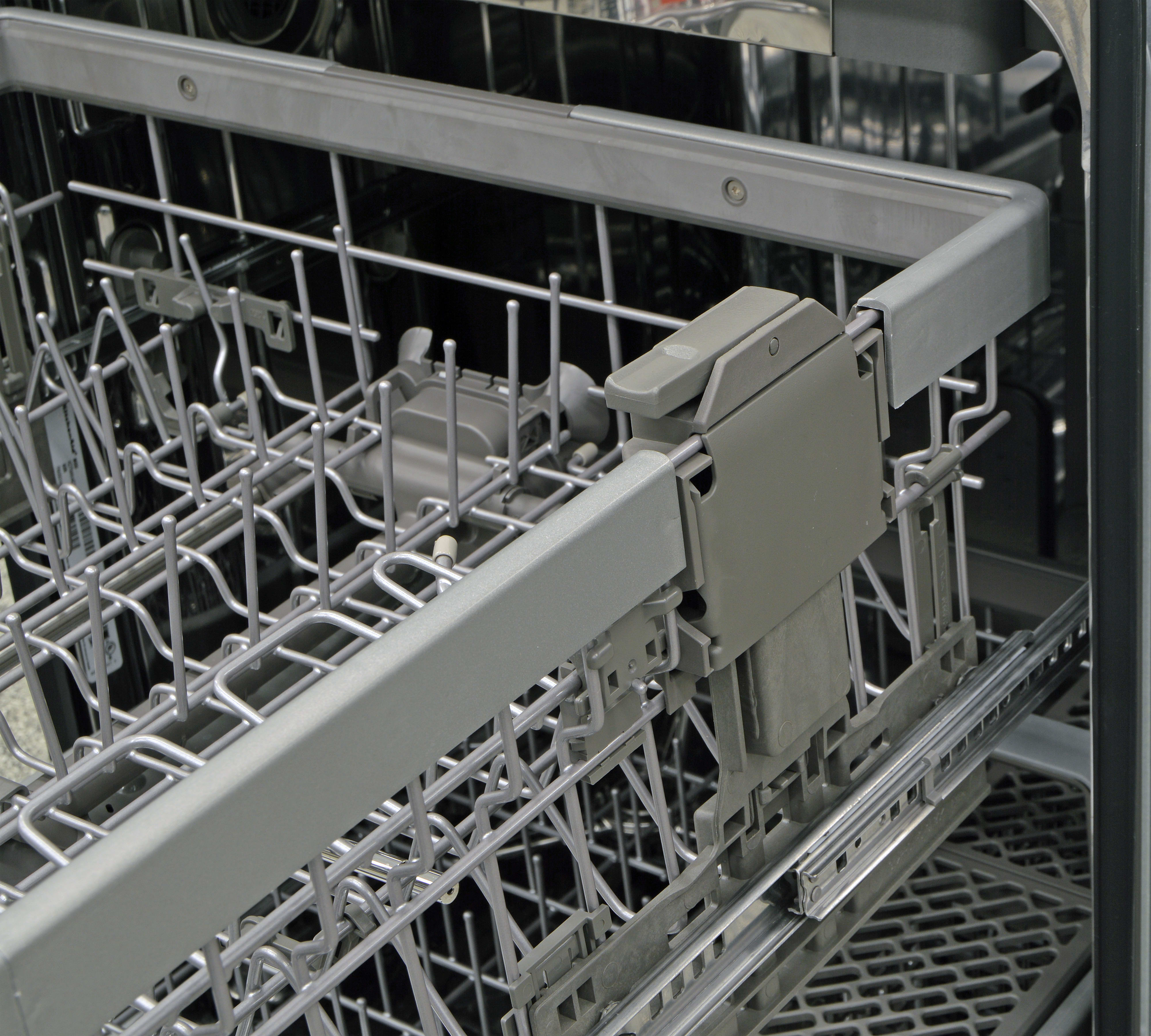 Height adjustment switch on the upper rack