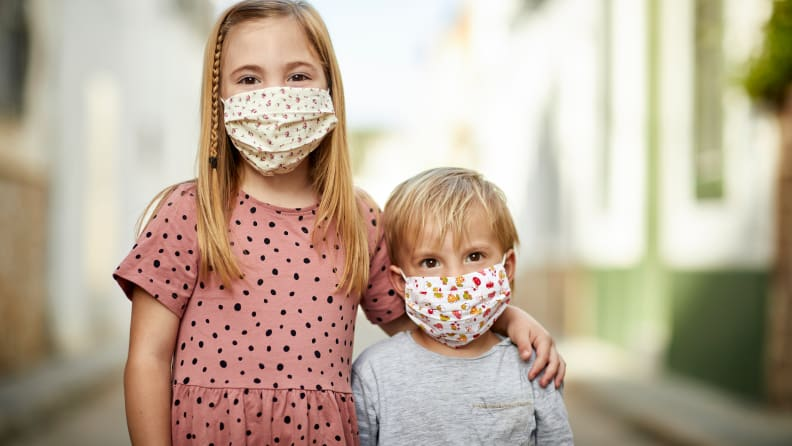 Girl and boy in masks