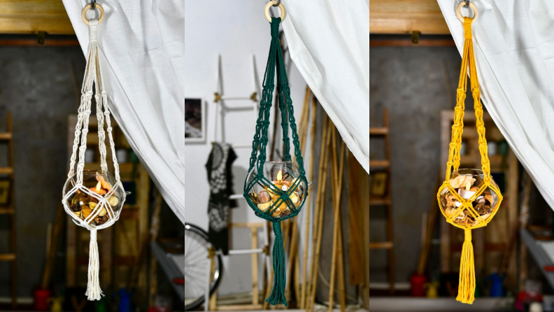 Cream, green, and gold macrame plant hangers house three leafy plants.