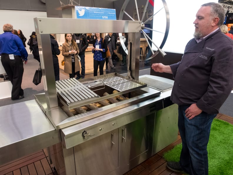Kalamazoo's own grillmaster, Russ Faulk, explained the features of the company's new gaucho grill.