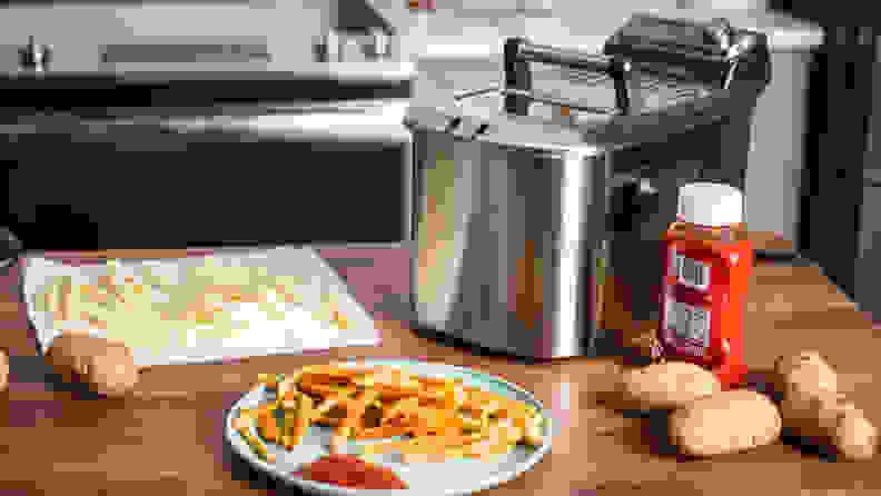 A Breville deep fryer sits on a kitchen counter.