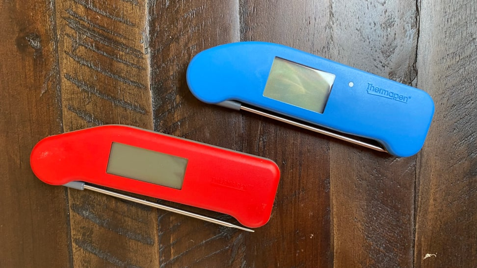 On the left, there's a ThermoWorks Thermapen MK4 instant read digital thermometer  in red and on the right, there's a Thermapen One in blue.