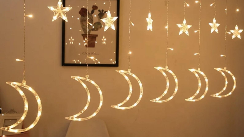 Celebratory stars and moons are lit as decorations.
