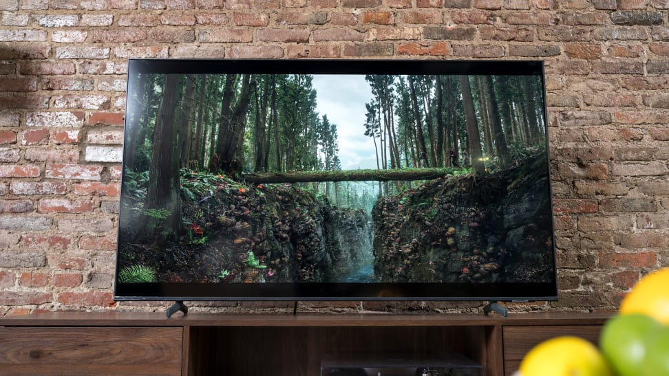 The Samsung Q60A QLED TV displaying 4K/HDR content in a living room setting