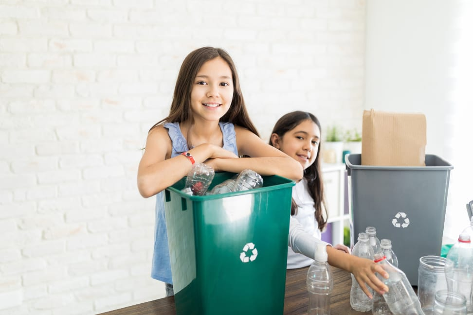 Two girls recycling