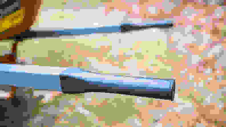 A close-up of black plastic wheelbarrow handles.