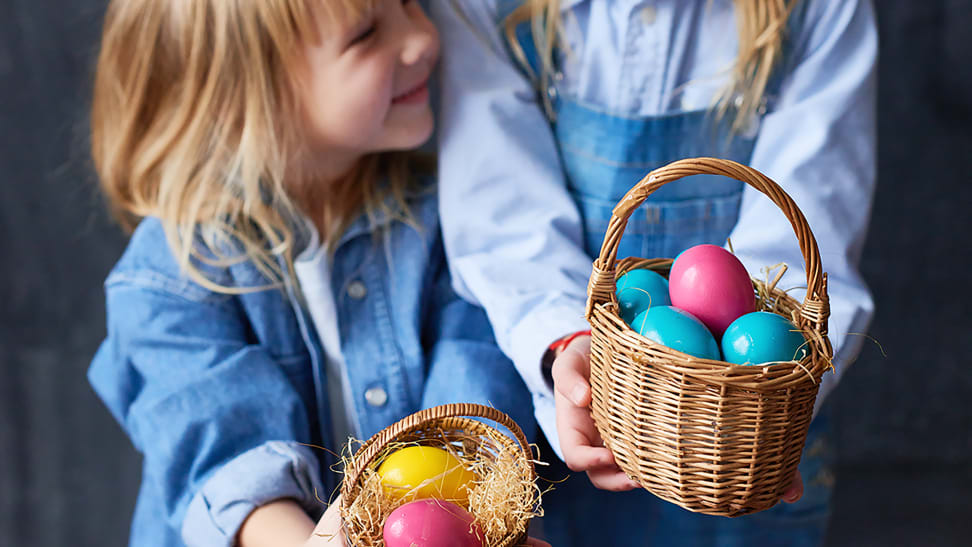 Two girls holding baskets with Easter eggs