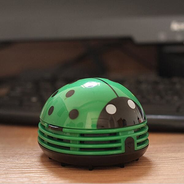 This adorable ladybug vacuum cleans tables and desks.