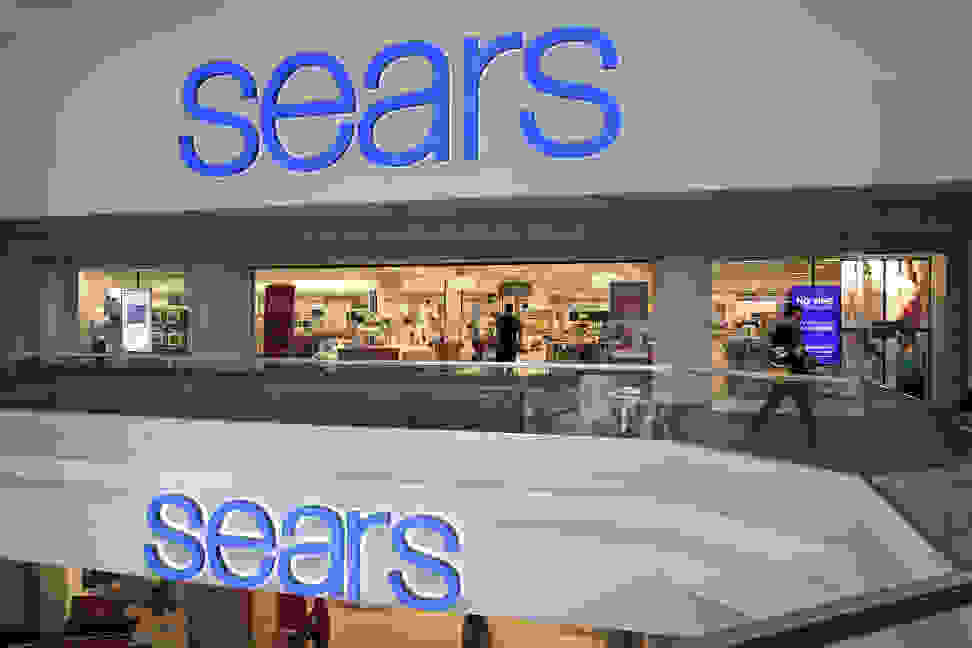People shop at a Sears store on March 22, 2017 in Schaumburg, Illinois. Sears Holdings, the parent of Kmart and Sears, Roebuck, & Co., said there is 'substantial doubt' about the company's financial viability