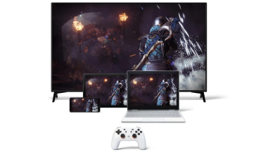 A Google Stadia set up with access to television, laptop, mobile phone, and smartpad.