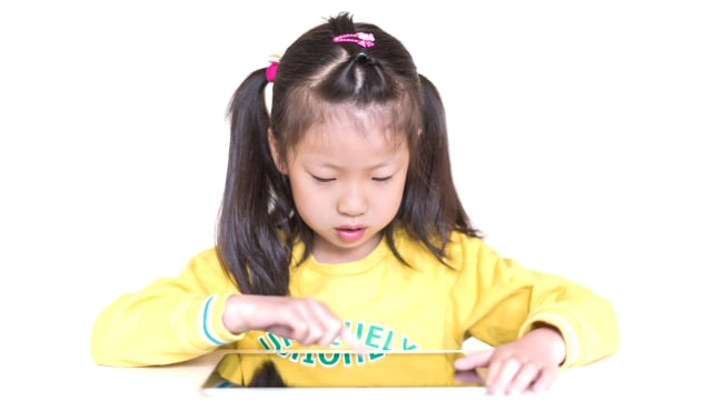 Young girl learning in a tablet