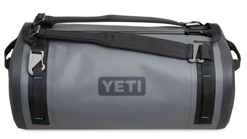 Product shot of gray and black YETI duffel bag.