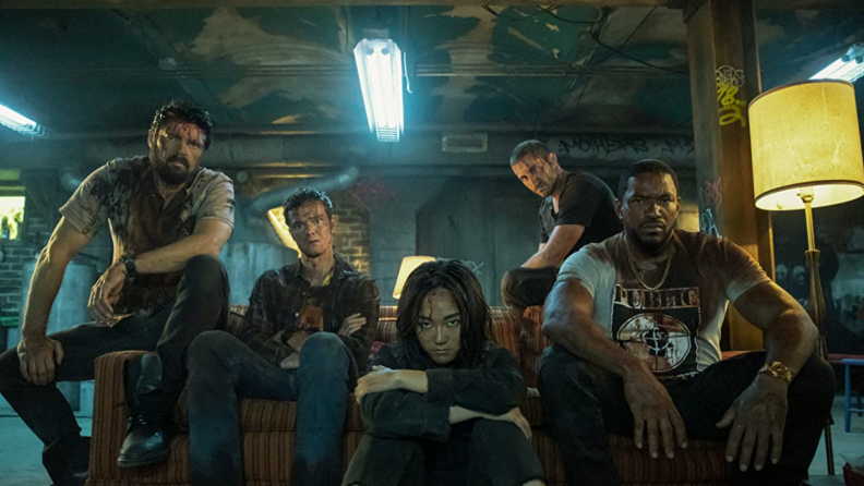 A still from The Boys featuring many of the characters covered in blood.