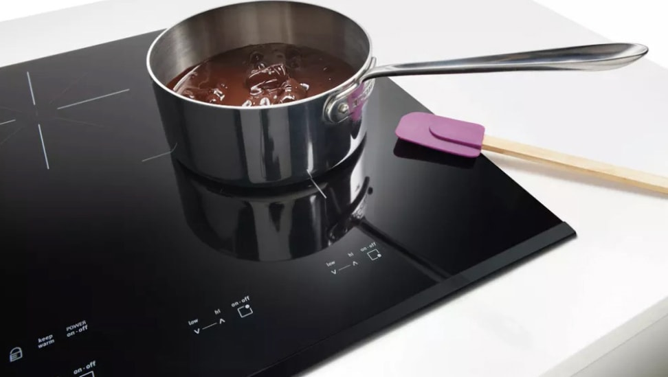 The Frigidaire Gallery FGIC3667MB is an induction cooktop. Induction cooktops only heat iron pots and pans, so the spatula won't melt onto the cooktop.