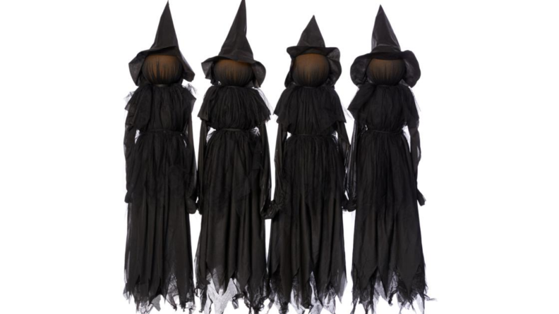 An image of a set of lawn witches in black shroud-like dresses and pointy hats.