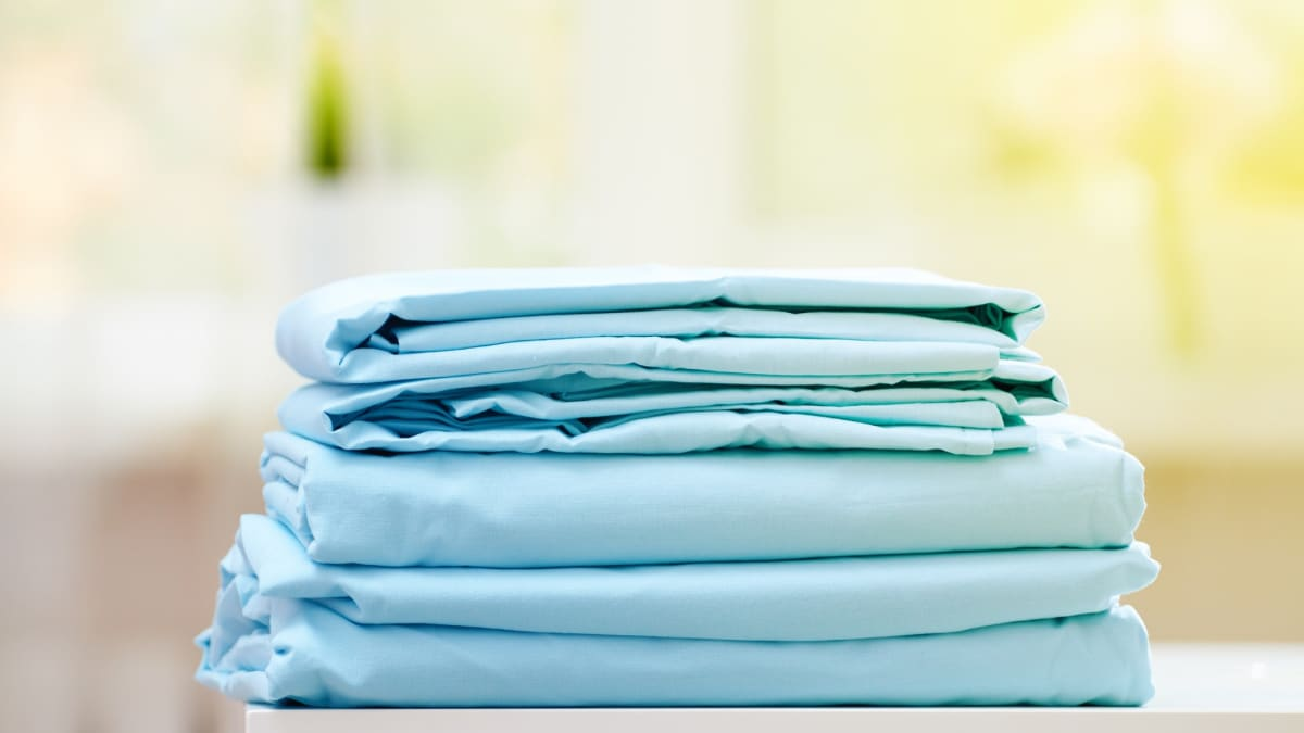 We tried the viral fitted sheet folding hack—here's what happened