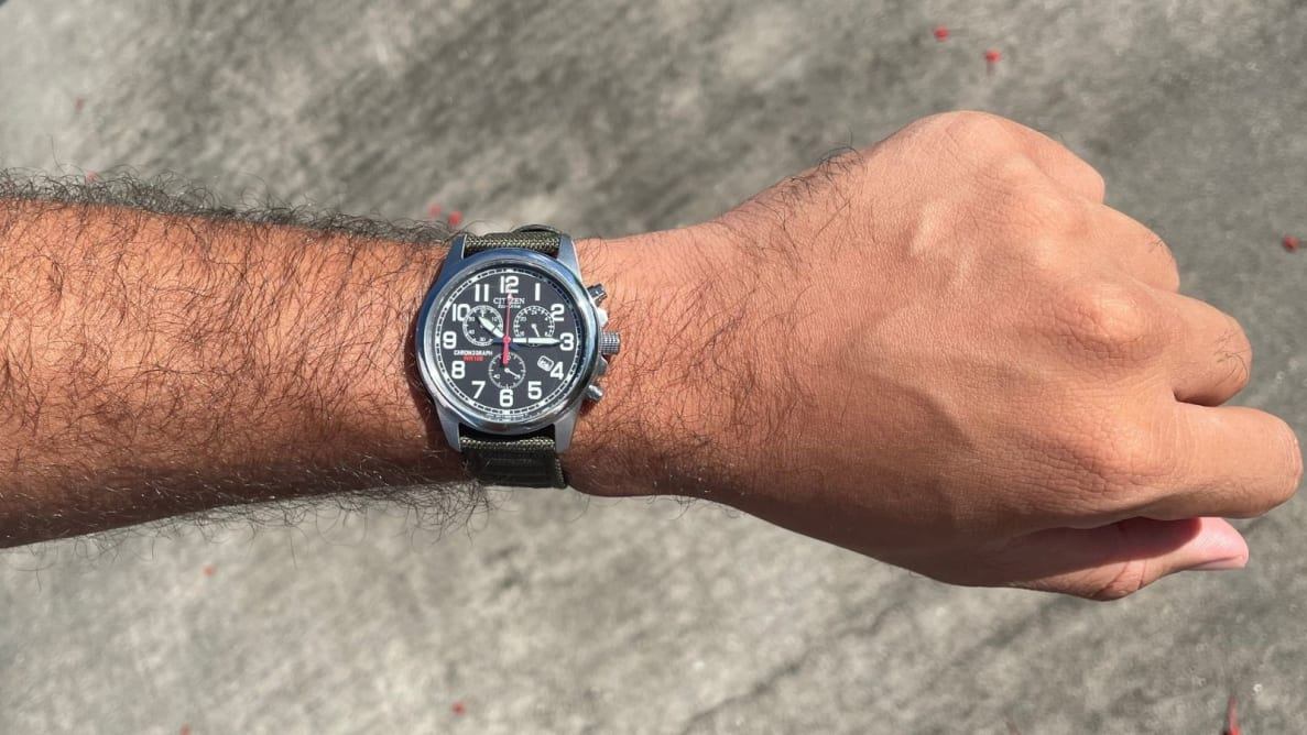 Man showing off Citizen AT0200-05E Eco-Drive Chronograph Canvas Watch on his wrist.
